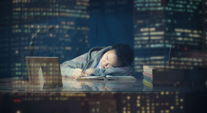 Male student falls to sleep while studying. Male student fell to sleep in studying late night while studying for a test. School boy lazy to study the test for Stock Images