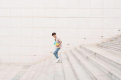 Male student going down the stairs, blurred motion.  Stock Photography