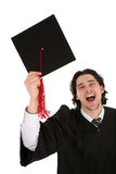 Male student graduating. Portrait of a man in graduation robes Stock Photos
