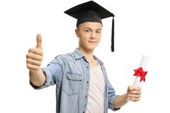 Male student with a graduation cap and diploma showing thumbs up. Isolated on white background royalty free stock images