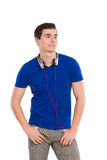 Male student with headphones. Happy student in blue t-shirt with headphones. Full length studio shot isolated on white Stock Photography