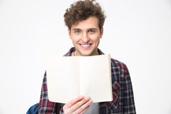 Male student holding blank notebook. Happy young male student holding blank notebook Royalty Free Stock Photography