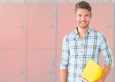 Male student holding book in front of lockers. Digital composite of male student holding book in front of lockers Stock Photos