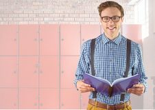 Male student holding book in front of lockers. Digital composite of male student holding book in front of lockers Stock Photo