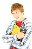 Male student holding books. Standing over white background Stock Photo