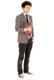 Male student holding books. Smiling Royalty Free Stock Photography