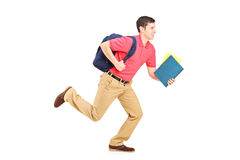 Male student holding books and running. Isolated on white background Royalty Free Stock Photography