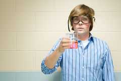 Male student holding chemical in flask Stock Photo