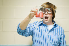 Male student holding flask of chemicals Royalty Free Stock Photos