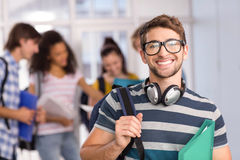 Male student holding folder in college. Portrait of happy male student holding folder in college Stock Image