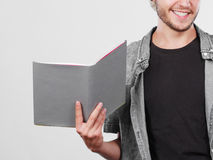 Male student holding textbooks. Leisure, education, literature concept. Young handsome male student holding textbooks book Stock Photo
