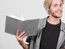 Male student holding textbooks. Leisure, education, literature concept. Young handsome male student holding textbooks book Royalty Free Stock Images