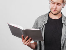 Male student holding textbooks. Leisure, education, literature concept. Young handsome male student holding textbooks book Royalty Free Stock Photography