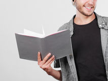 Male student holding textbooks. Leisure, education, literature concept. Young handsome male student holding textbooks book Stock Images