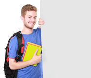 Male student holding white blank board Royalty Free Stock Images