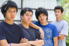 Male student ignored by his friends. A hispanic student was ignored by his Asian friends Royalty Free Stock Photos