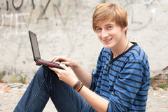 Male student with laptop Stock Images