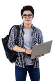 Male student with laptop isolated Royalty Free Stock Photography