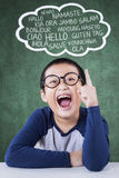 Male student learn multi language. Portrait of attractive little boy studying multi language in the class Royalty Free Stock Image