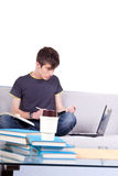 Male student learning. Young male student learning with laptop and books Royalty Free Stock Photo