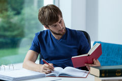 Male student learning for exam. At home Stock Photography