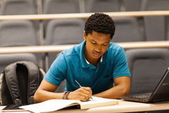 Male student lecture room. Male african college student in lecture room Stock Photography