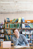 Male student in library looking up.  Royalty Free Stock Image