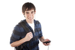 Male Student listening to music. A young male student listens to music on his MP3 player Royalty Free Stock Photography