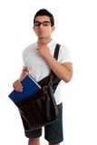 Male student looking sideways. Ethnic male student holding a book and satchel, looking sideways.  White background Stock Photos