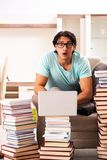 The male student with many books at home royalty free stock photos