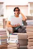 The male student with many books at home stock images