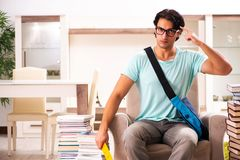 The male student with many books at home royalty free stock photo