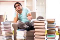 The male student with many books at home royalty free stock photography