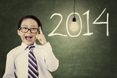 Male student with number of new year 2014 Royalty Free Stock Image