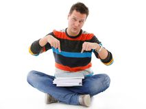 Male student offering books isolated Royalty Free Stock Photography