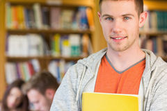 Male student with others in background at the library Royalty Free Stock Photo