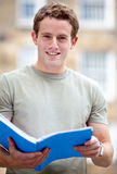 Male student outdoors Stock Images