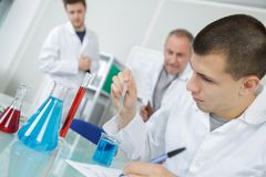 Male student performing science experiment. Science Stock Photography
