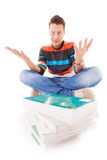 Male student with pile of books preparing for exam isolated Royalty Free Stock Image