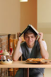 Male Student in pizzeria with Laptop. Indoor shot Stock Photo