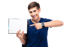Male student pointing finger on blank paper. Happy male student pointing finger on blank paper isolated on a white background. Looking at camera Stock Image