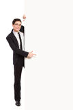 Male student pointing at white banner. Young man in black suit pointing at the banner. Full length studio shot isolated on white Stock Photos
