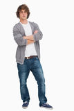 Male student posing with crossed arms. Against a white background Royalty Free Stock Photos