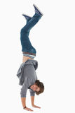 Male student posing handstands. Against a white background Stock Image