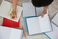 Male student preparing. For exam indoors Royalty Free Stock Photos