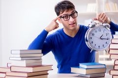 The male student preparing for exams in college library. Male student preparing for exams in college library Stock Image