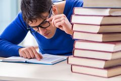 The male student preparing for exams in college library. Male student preparing for exams in college library Royalty Free Stock Photo