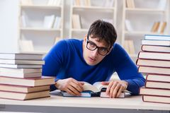 The male student preparing for exams in college library. Male student preparing for exams in college library Royalty Free Stock Image