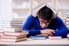 The male student preparing for exams in college library. Male student preparing for exams in college library Royalty Free Stock Photography