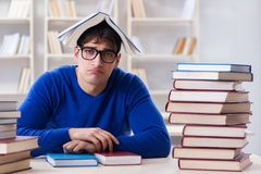The male student preparing for exams in college library. Male student preparing for exams in college library Royalty Free Stock Photos